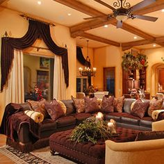 This is just everything I want in a living room. Comfort, class, warm colors and most important, enough room for family and guests.