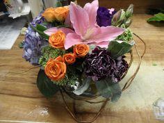Pink, blue, orange flower arrangement for wedding and events.