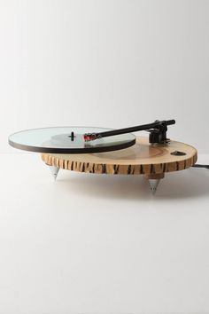 A pitch-perfect piece of nature, this smooth slice of ashwood is outfitted with a Premotech motor and a Rega tonearm, a weighty glass platter and adjustable spike legs. By Audiowood. Presented by Anthropologie.