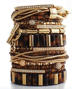 Michael Kors stackable bracelets...they'd go perfectly with my gold/tortoise watch!!