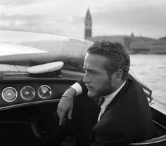 Paul Newman, Venice 1963, being run about in a woody taxi boat.