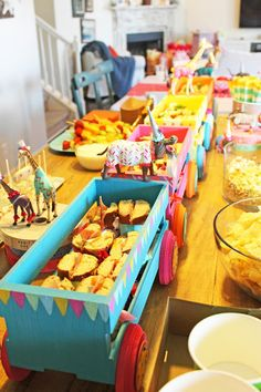 dumbo baby shower, circus animals, circus wagons, food table decorations The ragged wren Circus Party Foods, Circus Food, Circus Carnival Party, Circus Theme Party, Circus Baby, Circus Train, Dumbo Birthday Party, Carnival Birthday, Baby Party