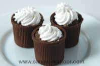 Chocolate Cups With Chocolate Mousse: Chocolate mousse served in chocolate cups.
