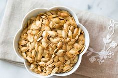 Roasted Pumpkin Seeds ~ Don't throw away the pumpkin seeds from your pumpkin!  Roast them for a delicious healthy Halloween snack ~ SimplyRecipes.com