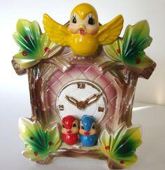 Vintage Wall Pocket Cuckoo Clock Planter Yellow Bird Christmas Holly Leaves. $34.00, via Etsy.