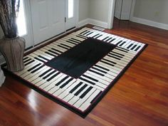 This piano keyboard rug would look nice in a music teaching studio. | Music Home Decor