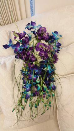 #bluewedding #blueorchids #cascadebouquet  #artisticbloom