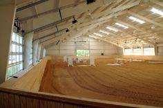 Indoor riding arena with roll-up, garage door type windows