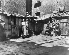 View the picture 'NYC from the photo gallery ''How the Other Half Lives': Photos capture New York slums in on Yahoo News. Three young street arabs huddle together for warmth in an areaway, Mulberry St, New York. (Photo by Jacob A Riis/Getty Images) Lower East Side, Photos Du, Old Photos, Lewis Wickes Hine, Haunting Photos, Vintage New York, Vintage Italian, Vintage Black, Gilded Age