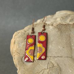 These earrings were created using a kiln firing method. Copper is cut, filed and sanded. Fine glass powder is then layered on the copper and heated the piece with a kiln. These last two steps are repeated many times until the final look is achieved. Each of my products is an original. That´s why even the same item can be partly different from the photograph - as for the size, pattern or colour. the size without hooks: 1.18 x 0.35 in