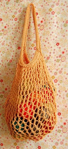 "This pretty tote bag was designed by Elisa, an Italian knitter and blogger who saw the Climbing Trellis Lace Pattern here on the Purl Bee.  She calls it her ""No More Plastic Bag, Thank You!"" It is a fast knit that takes only a few hours to complete. Elisa's Nest Tote can be made from just about any cotton yarn (linen or hemp yarn work nicely, too). The stretchy lace stitch makes this bag practical and quite durable. We would choose this dainty and durable tote over a plastic bag any day!"