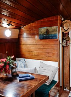The stern – looking from kitchen / dining area towards the back deck of the boat. Dining area, which folds down and doubles as sleeping for guests if needed.