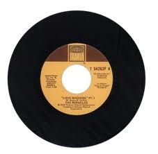 In 1976, Love Machine by The Miracles  http://www.youtube.com/watch?v=5LFcY5DML5w