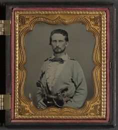 (c. 1861-1865) Soldier from Kentucky in Confederate uniform with two revolvers.