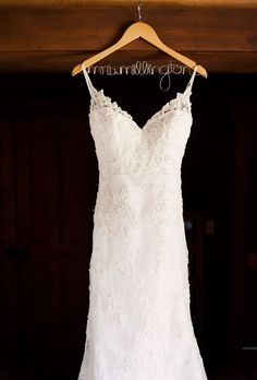 "Brides.com: . When it came to her dress, Kristin wanted something different—something ""that I hadn't seen a lot of,"" she says. The plunging back of the bride's lace Casablanca gown and its intricate head-to-toe beading fit the bill."