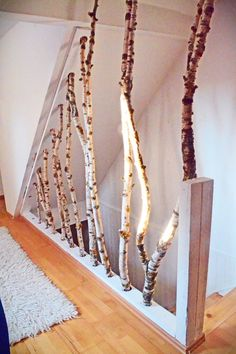 Branches as a partition and decoration element for the stairs. More Creative stair railing. Branches as a partition and decoration element for the stairs. More Source by Stair Banister, Wood Stairs, Banisters, Stair Risers, House Stairs, Woodworking Bench, Woodworking Projects, Woodworking Garage, Youtube Woodworking