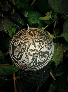 This unique Celtic Symbol Necklace features the Celtic Hounds. It has been fully handcrafted out of copper and given an antiqued finish with a protective waxed coating. It rests upon an adjustable bla Wiccan Jewelry, Viking Jewelry, Personalized Jewelry, Handmade Jewelry, Unique Jewelry, Celtic Mythology, Celtic Symbols, Hound Dog, Pendant Earrings