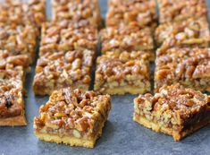 TESTED & PERFECTED RECIPE – With a buttery shortbread crust & rich caramel-pecan topping, these pecan squares are truly over-the-top. Potluck Desserts, Dessert Recipes, Pecan Desserts, Thanksgiving Desserts, Canadian Thanksgiving, Thanksgiving Ideas, Dessert Ideas, Pecan Bars, Shortbread Crust
