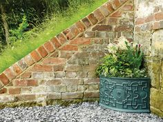 The RHS Heritage Corner Pot blends seamlessly into the courtyard (shown). The verdi gris finish was introduced to the range in 2016 and remains a popular choice with Riverhill Garden Supplies customers Garden Planters, Planter Pots, Corner Garden, Garden Features, Back Patio, Garden Supplies, Container Gardening, Stepping Stones, Garden Design
