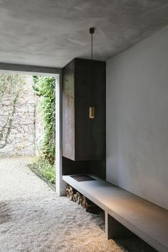 Outdoor wood-burning fireplace with concrete bench. Project Renovation House V in Antwerp, Belgium, designed by Hans Verstuyft Architecten. Photographed by The Fresh Light. Contemporary Architecture, Interior Architecture, Interior And Exterior, Interior Design, Outdoor Wood Burning Fireplace, Kitchen Wall Design, Magazine Deco, Concrete Bench, Outside Room