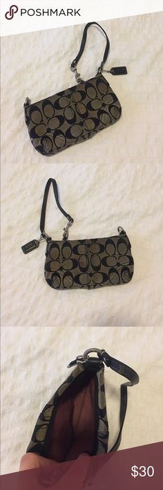 COACH wristlet in black monogram COACH wristlet in black monogram. Canvas body with leather straps. Some staining on canvas (see photos please) that might be able to be cleaned off - I️ haven't tried. Amazing quality product!! Coach Bags Clutches & Wristlets