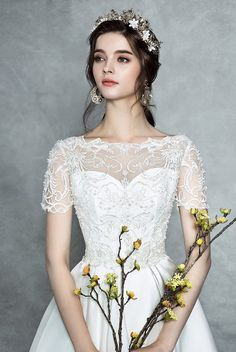 This romantic gown from St. Mariee featuring beautiful detailing is guaranteed to dazzle!