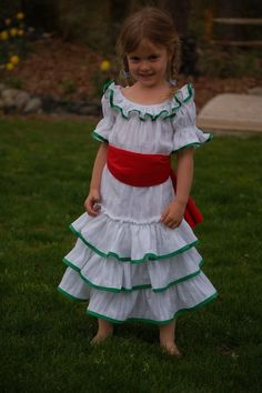 $65 - This Mexican Ruffle dress is a unique design that I created from looking at different patterns. It has intricate ruffle designs, the fabric is a gauze and the ribbon and fabric color ads a bit a pizzaz to this oh so cute dress. It makes a cute stylish dress up dress, or even a dress for your child to wear to a wedding or party. Your little girl is going to love to dance in this gorgeous dress.    This particular dress in the pictures is a size 3-4 yrs. It is 29 in. long (back of neck…