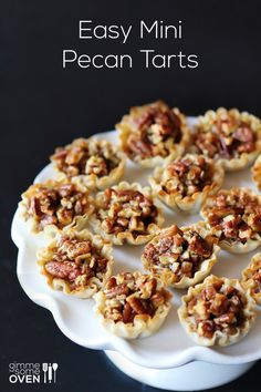 Pecan tarts...these look so much more nutty and delicious than too-sweet gooey pecan pie