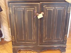 Distressed black cabinet has tons of character and storage