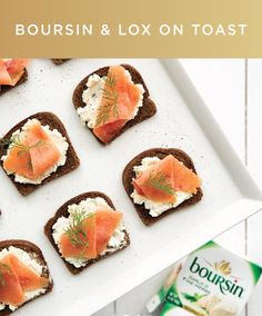 This quick and easy appetizer is perfect for any party–planned or impromptu. Spread Boursin cheese on miniature pumpernickel toasts and top with smoked salmon and dill.