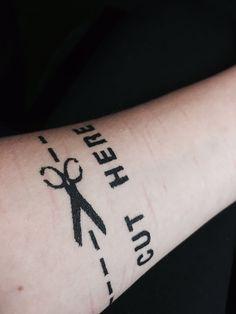 Cut here. Self harm tattoo