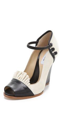 Very feminine wedges from Moschino, in elegant black and cream combo.