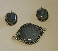 Denim scraps set in resin in this pendant and earring set