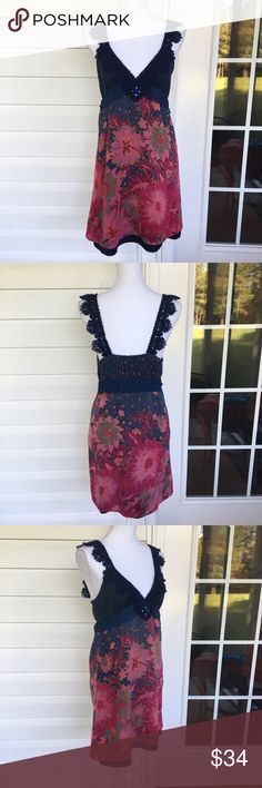 "Free People Wool Pleated Lace Dress With a wool shell and a cotton lining, this Free People dress is a charming casual piece. The top is made from Lacey wool navy straps. The skirt has a wool shell with a pink floral design. The cotton lining is trimmed with navy pleats. In good condition, but some pilling on the wool. Approximate measurements lying flat: Bust 16.5"", Waist 15"", Length 36.5"" 30203 Free People Dresses Midi"
