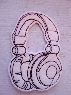 Machine embroidered headphones iron on patch applique.    Brown stitches on cream felt.Machine washable and dryable.Iron on