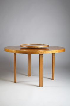 Dining table with carousel designed in 1930s by Alvar Aalto. L-leg design, which is used for this table, is one of the most creative design by Alvar Aalto, and patented in 1933. I think the carousel makes this table different from other circular tables.