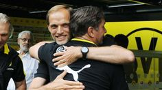 Glückliche BVB-Gesichter! Zorc (r.) umarmt Trainer Tuchel
