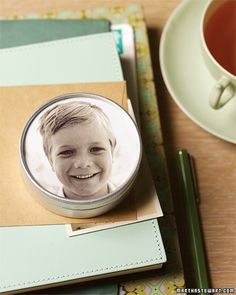 Brighten your desktop by slipping a picture of a familiar face into the lid of a round tin. Here, a black-and-white photograph was added to a small metal tin with a glass lid (available at crafts stores in assorted sizes). It can hold pins, paper clips, and the like.