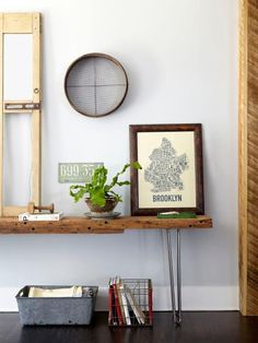 4: The art in the living room includes a grain sifter used by Katy's grandparents and an Ork Posters print of Brooklyn, where Ken lived for three years. 5: With help from midcentury-style hairpin legs bought on Etsy, a plank of rugged wood was transformed into a console.