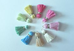 DIY Tassels: A Do-It-Yourself Tutorial on how to make tassels using embroidery thread. Use tassels to make earrings, bracelets, and more!