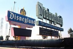 For a brief time in 1989, the original Disneyland sign and it's electronic replacement stood together
