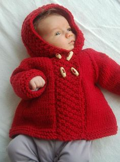 A timeless classic: the double-breasted A-line pea-coat with a nice fitted hood and cute details like a back flounce and textured front bands.Child Knitting Patterns Purple Using Coat child knitting sample by Lisa Chemery - Accessible at LoveKnitting