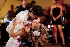 The bride and groom, lost in the moment on the dance floor - photo by Roey Yohai via JunebugWeddings.com.