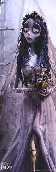 This is an image of Tim Burton's corpse bride Emily. The use of colour gives a very macabre atmosphere to the image and the expression on her face personifies her misery. The way the dress is faded into the backdrop makes her darker hair and face stand out which pronounces the sense of longing behind her eyes and could suggest that no matter how hard she tries she cannot be part of this world like she wishes to.