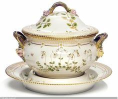 """""""Flora Danica""""- a circular tureen and stand, decorated in colours and gold with flowers"""