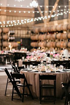 I love a warm and cozy wedding. One that you can just feel the love brightening the room, like this glowing winery wedding from Augie Chang Photography. Designed beautifully by Amazae Special Events with tables dressed in Wildflower Linens and set among rows of barrels