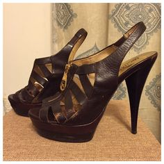 ‼️price reduced‼️Michael Kors gladiator platform. Brown leather gladiator platform with gold zipper detail.  About 4.5 inch heel with about 1.5 inch platform.  These are my favorite platforms and I hate to sell them but my feet can't take heels like they used to.  Worn gently.  Some scuffing near toe and some on the strap but in great condition.  These were purchased at the Michael Kors boutique a while back. Michael Kors Shoes Platforms