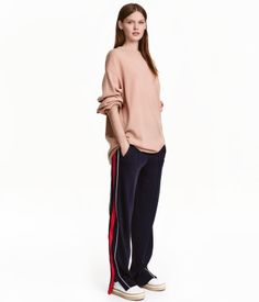 Dark blue. Loose-fitting jersey joggers in a viscose blend with piping and stripes along outer legs. Wide elastication at waist. Diagonal welt pockets with