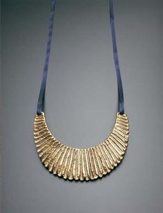 Lucie Rie Necklace, Earthenware, bright golden glaze over a carved body. 15.2 cm. (6 in.) wide,  c.1960