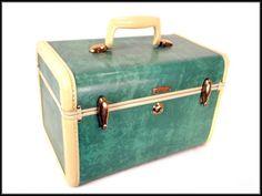 A beautiful Samsonite train case from the 50's in hard-to-find seafoam green.